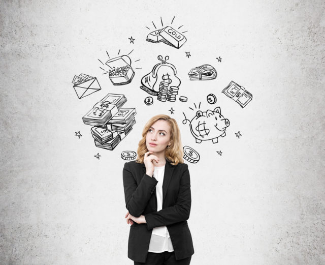 Business woman full of thoughts standing against concrete wall background with money sketches drawn on it. Concept of capitalism